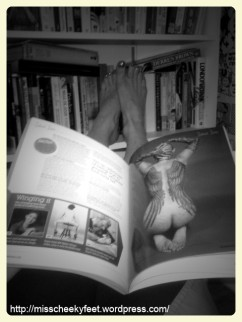 Bare feet up on the bookcase.