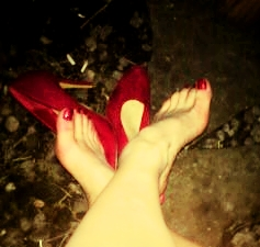 Kicking off my red high heels outside in the garden during the party. My feet were a bit hot & sweaty after all the dancing so I needed to cool them off.